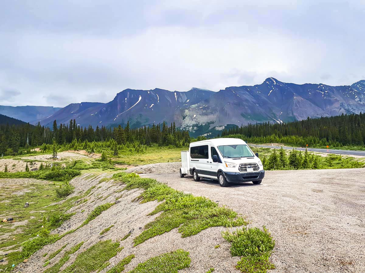 White van in the Canadian Rockies, accompanying the tour