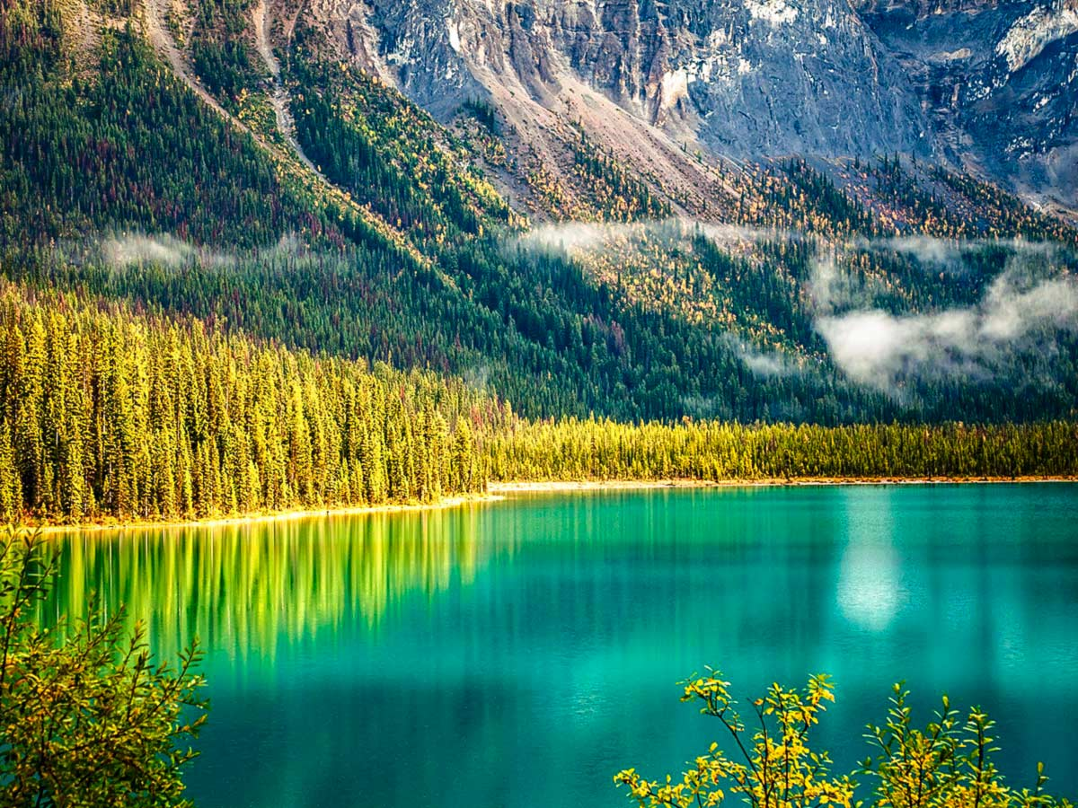 Beautiful mountains surrounding the Emerald Lake near Lake Louise