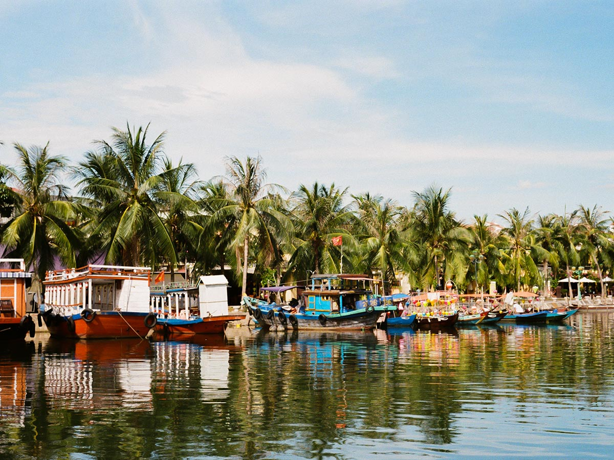 Boats in Hoi An seen on Coast of Vietnam Tour