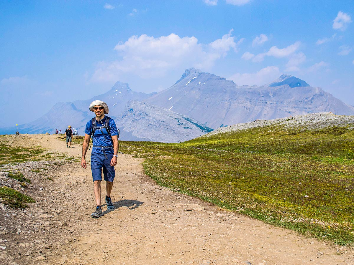 Happy hiker on a route to Parker Ridge in Canadian Rockies