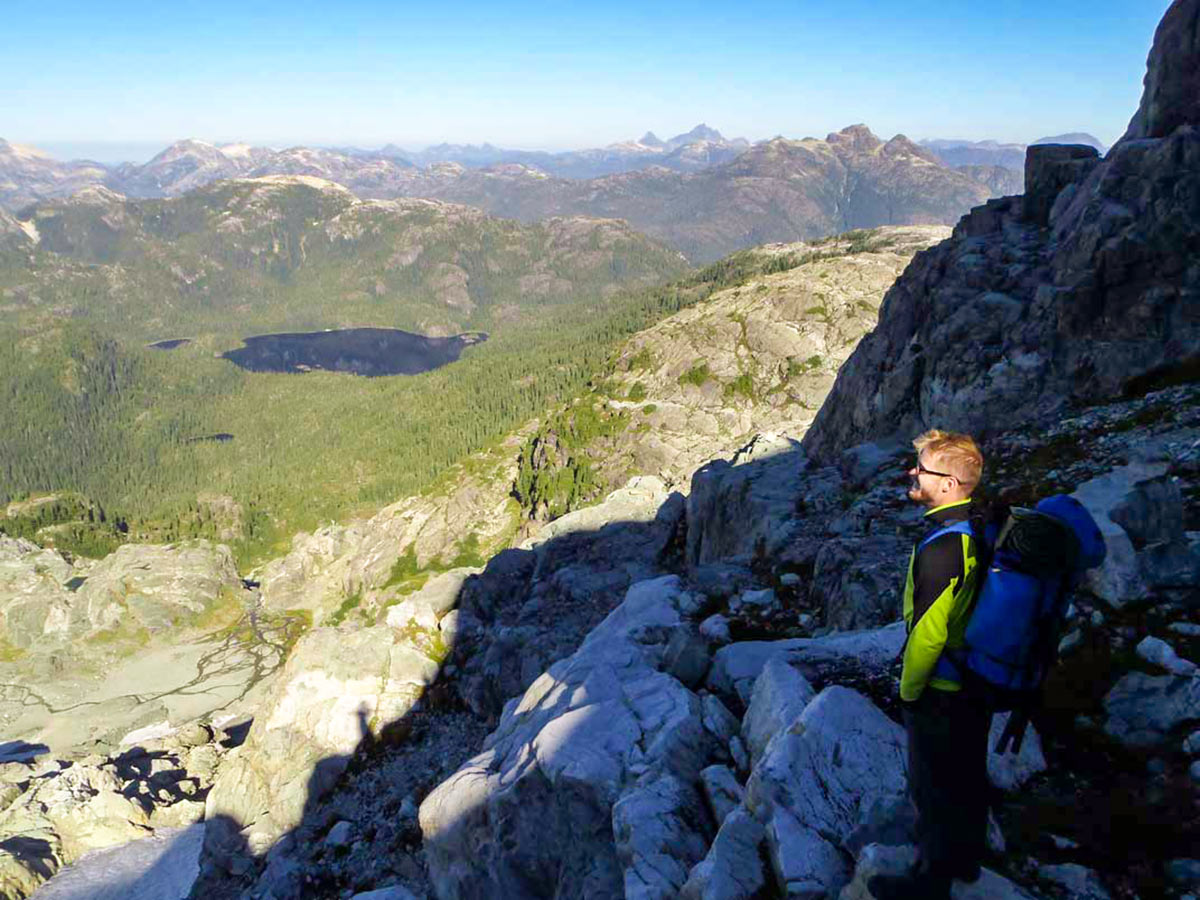 Hiker enjoying the views on Vancouver Island Hiking and Camping Tour with a guide