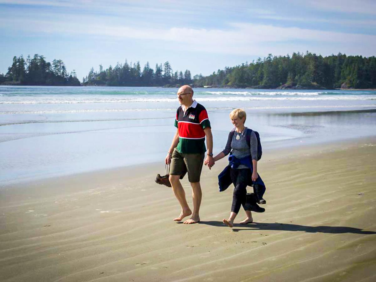 Couple walking along the beach on Vancouver Island