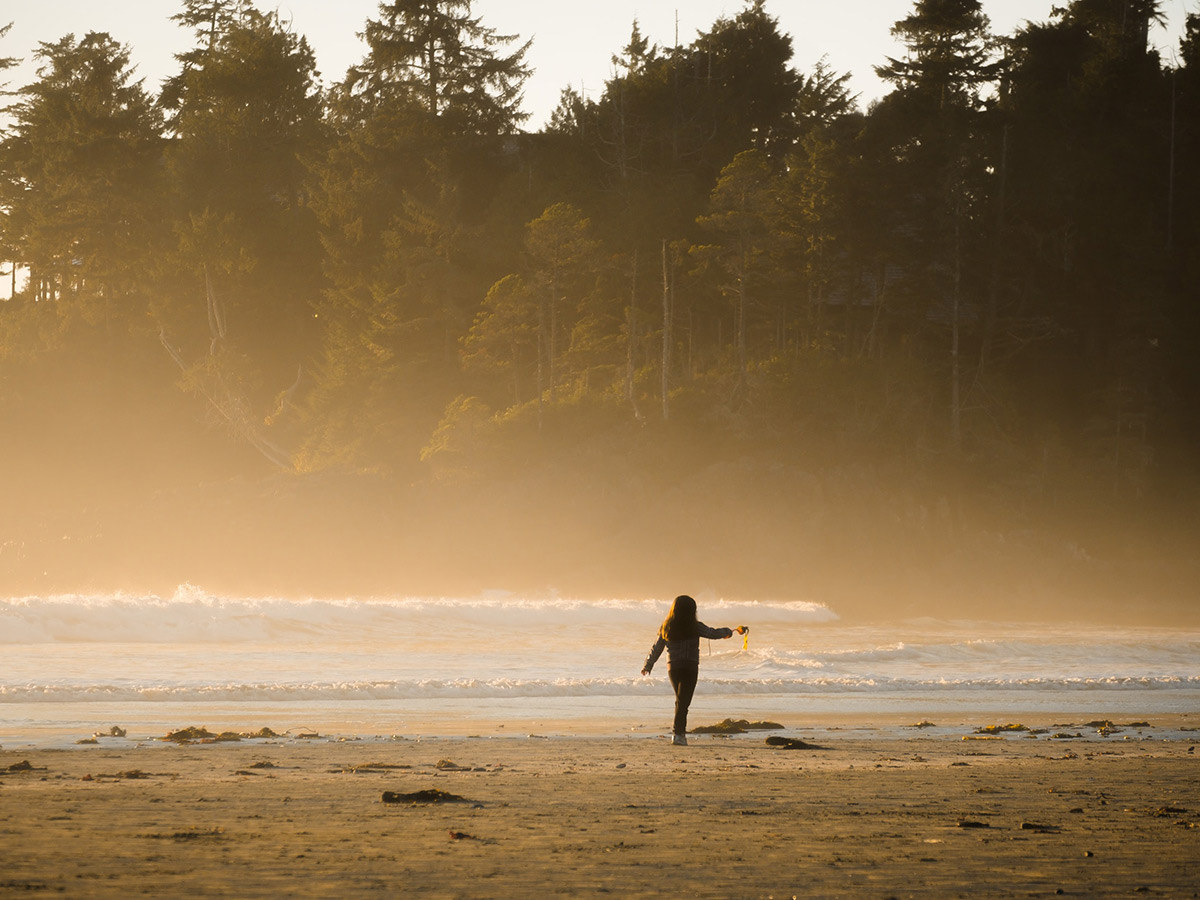 Lone hiker on a foggy beach on Vancouver Island Hiking and Camping Adventure
