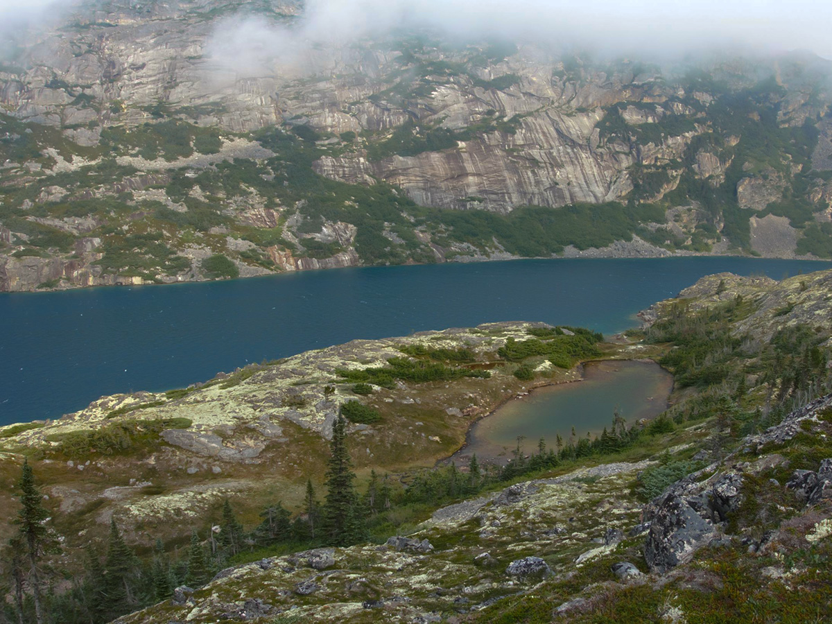 Overlooking the beautiful alpine lake on Chilkoot Trail tour with a guide
