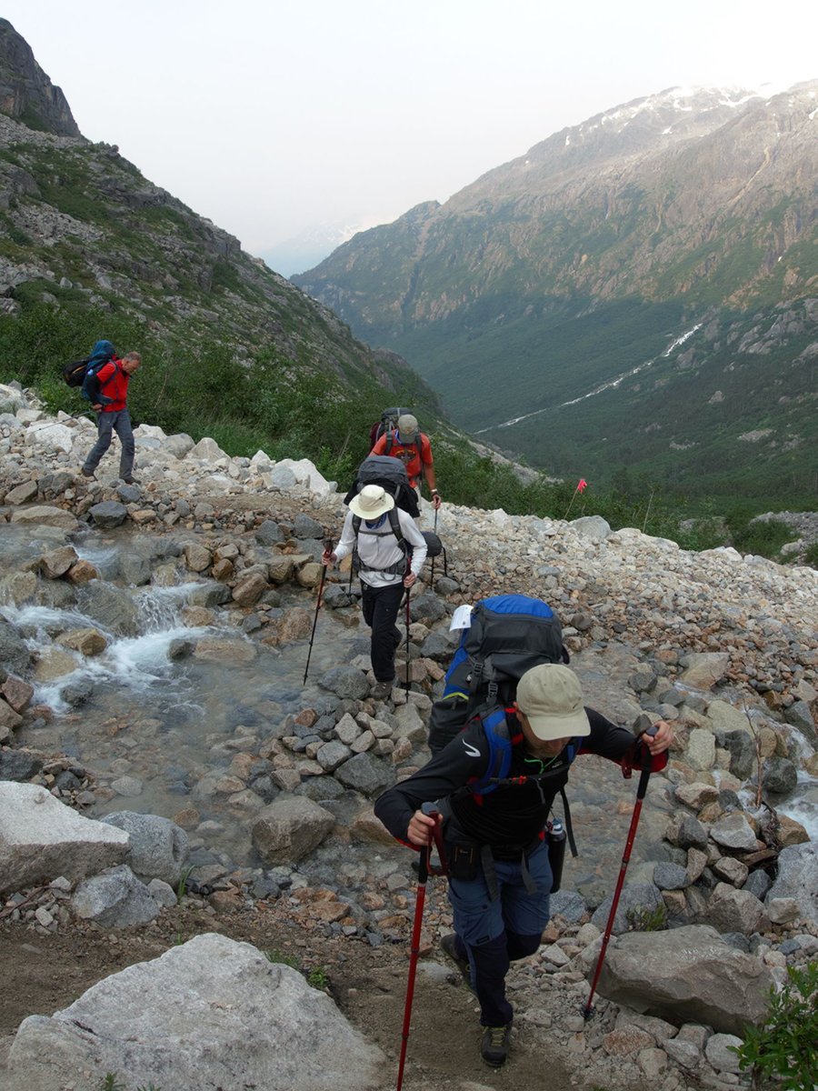 Crossing the alpine creek on Chilkoot Trail in Alaska and British Columbia