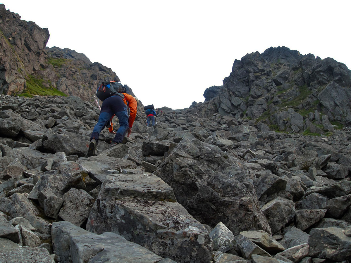 Scrambling to the pass on Chilkoot Trail with a guided tour