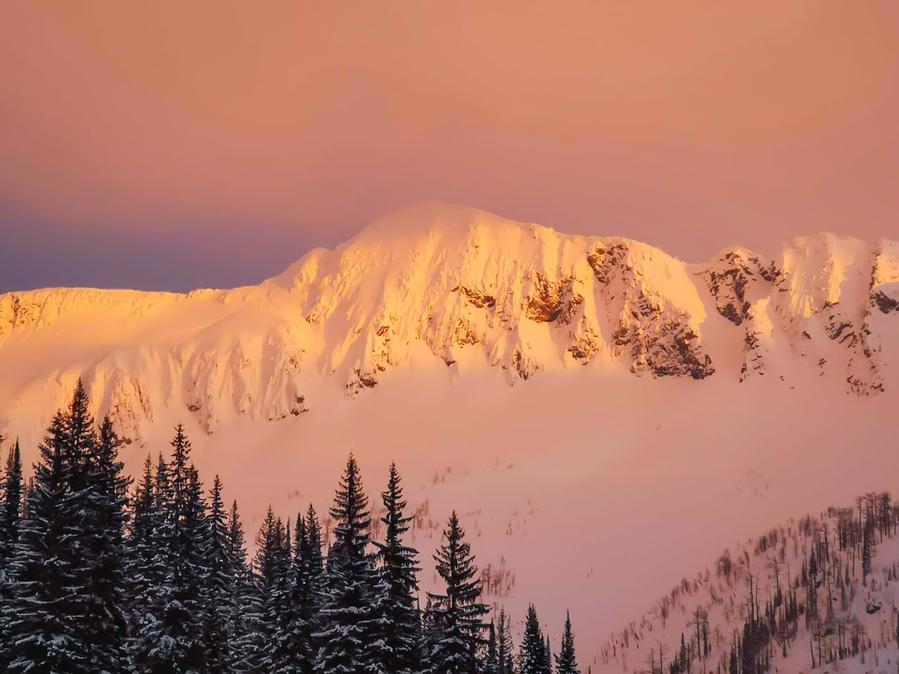 Sunset over snowy BC mountains