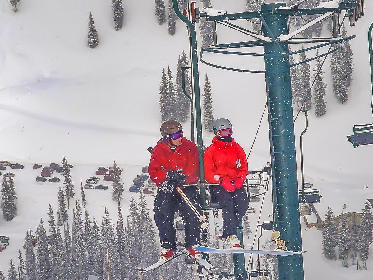 Two skiers on ski lift
