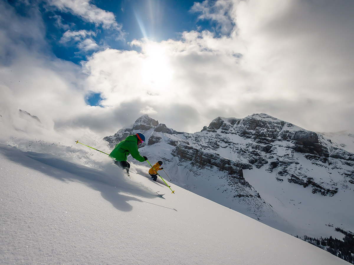 Two skiers on downhill ski trip