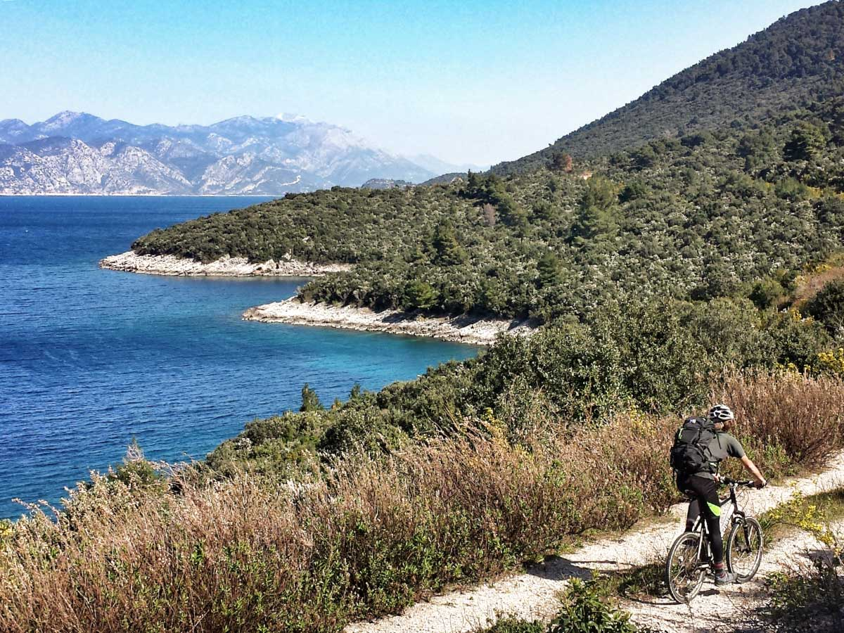 Cycling the beautiful trail along the Dalmatian Sea in one of the Croatian Islands