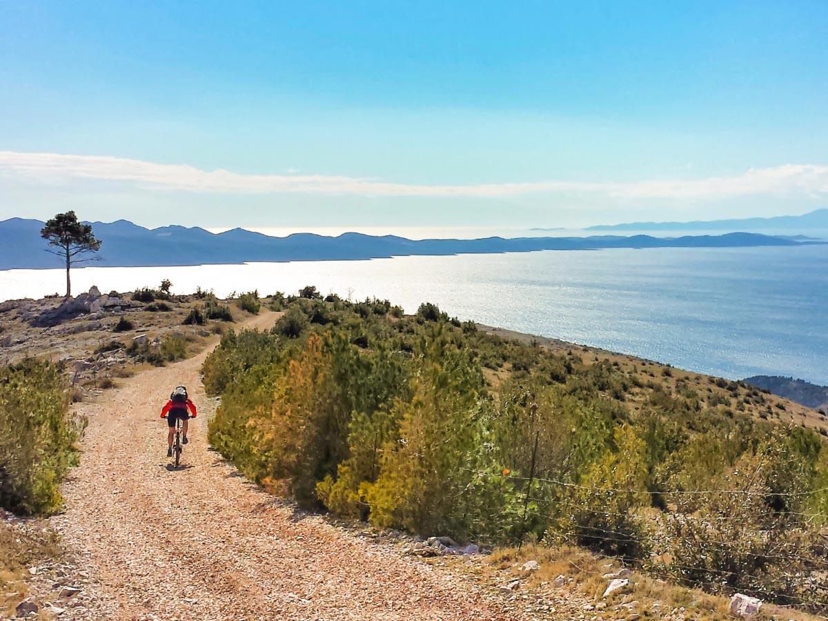 Biker riding the trail with Dalmatian Sea views in Croatia
