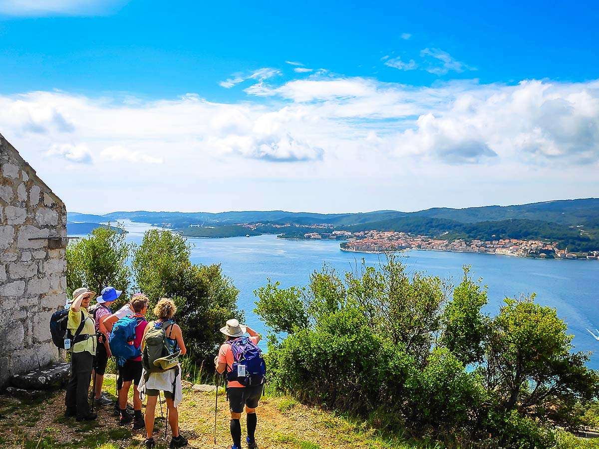 Group of hikers and stunning panoramic views of the Dalmatian Sea on a self guided hiking tour from Split