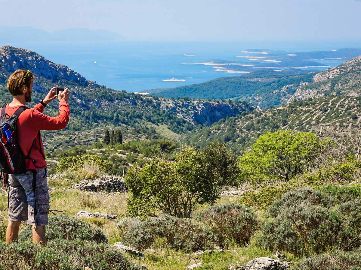 Hiker taking pictures of the stunning panorama between Split and Dubrovnik Croatia
