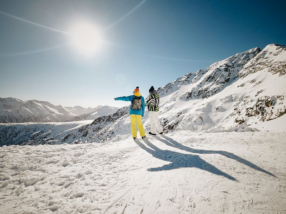 Two skiers admiring the views in Bulgarias snowy mountains