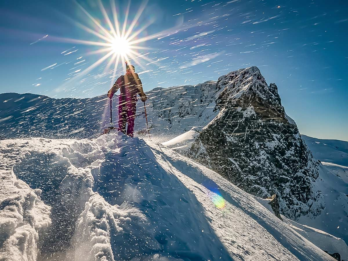 Snowshoer and the bright sun in the Bulgarias mountains