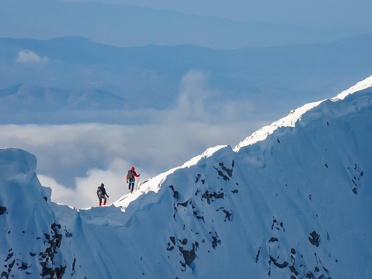 Snowshoeing along the mountain ridge in the Bulgarias mountains