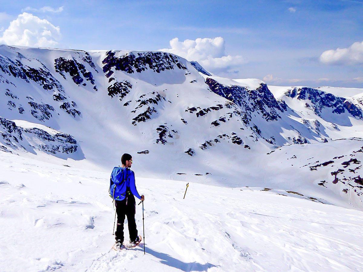 Lone snowshoer near Rila in Bulgaria met on snowshoeing tour