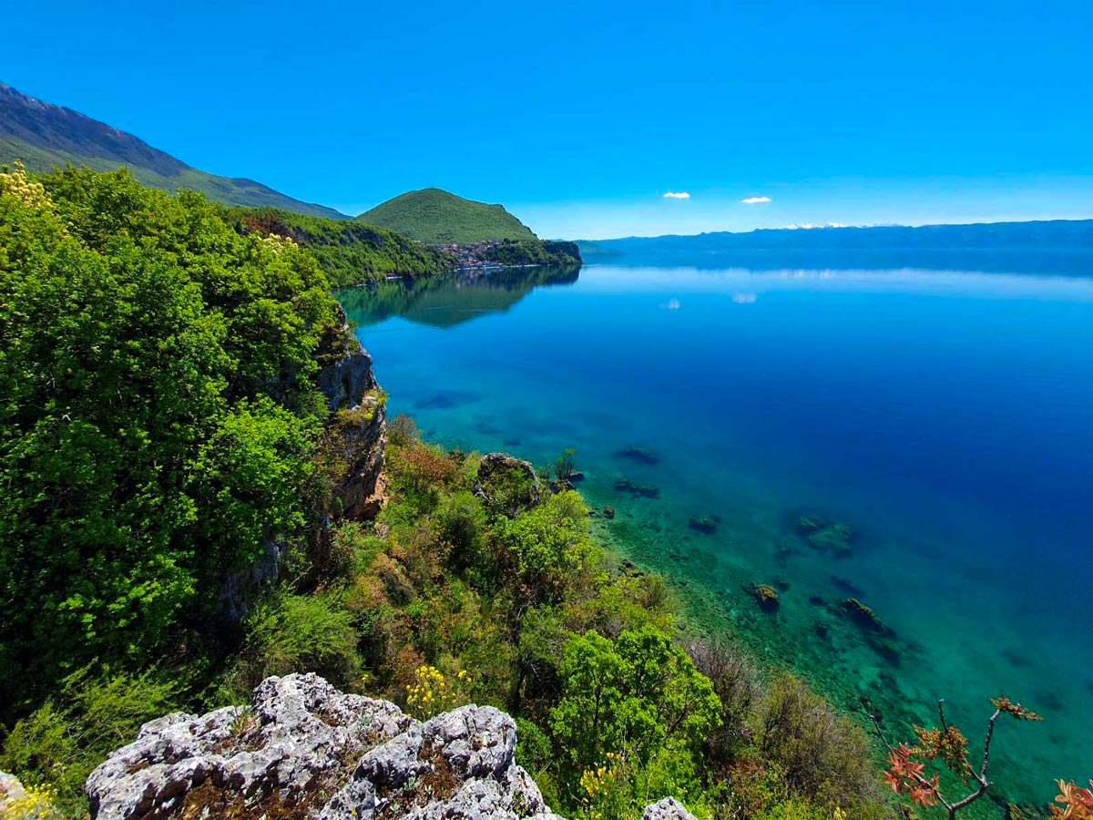 Hiking the Western Balkans tour rewards with some stunning views, such as Ohrid Lake view in Macedonia