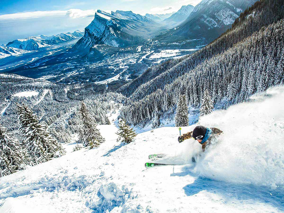 Skiing down the slopes of a mountain resort