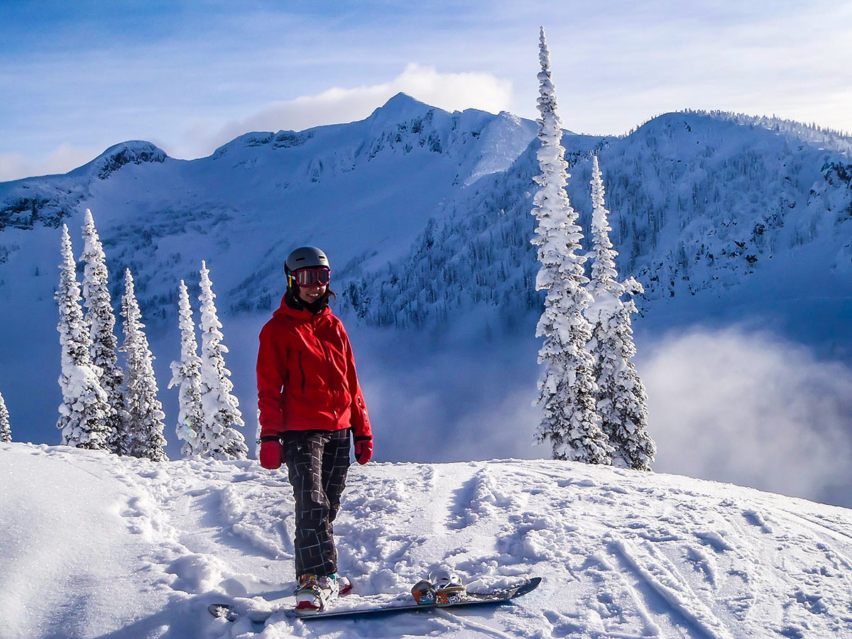 Skier posing on a mountain in the Canadian Rocky Mountains