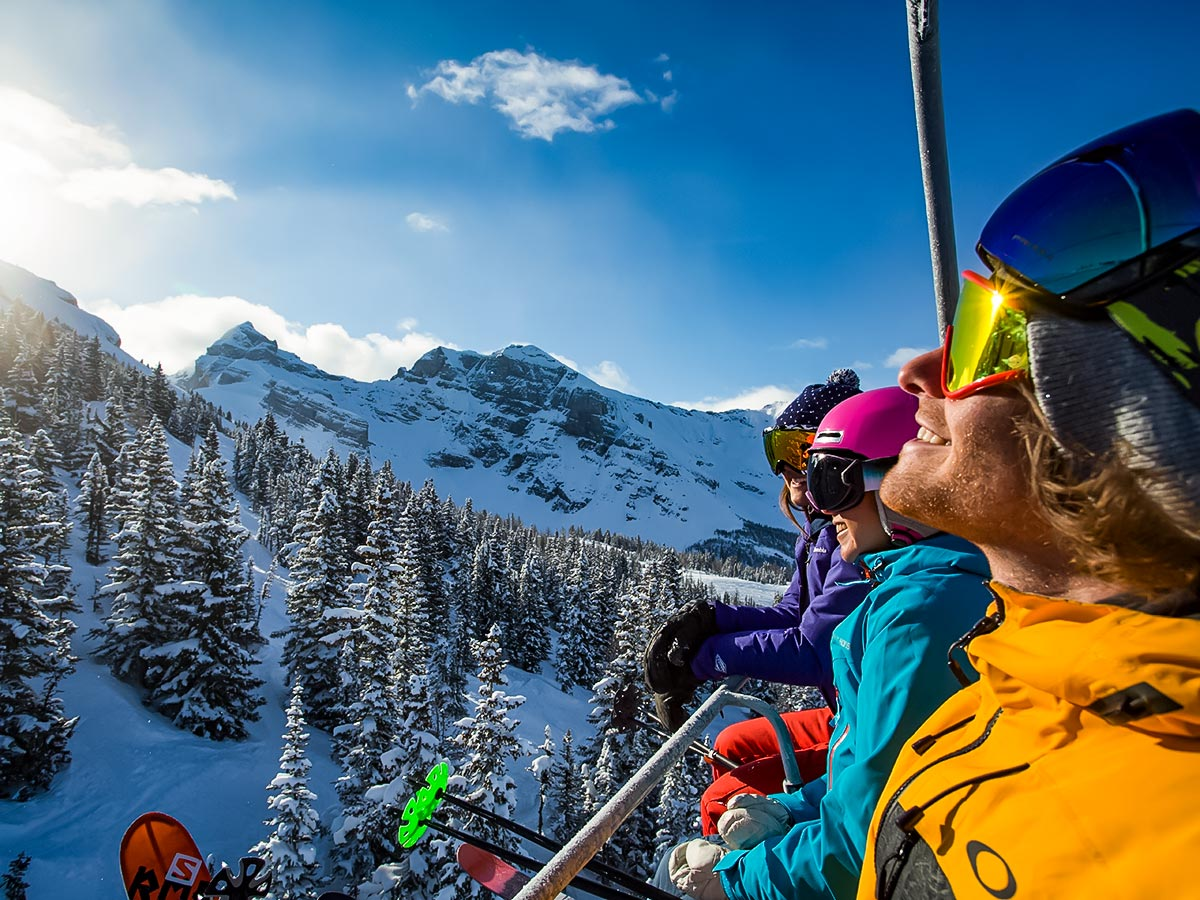 Skiers in Canadian backcountry on a guided ski tour