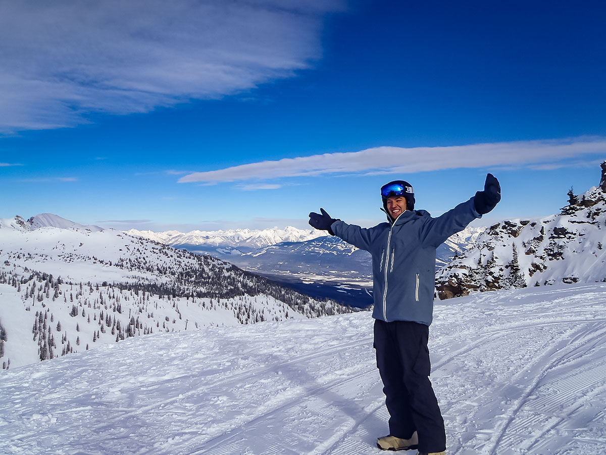 Skier posing on top of the mountain along the Powder Highway