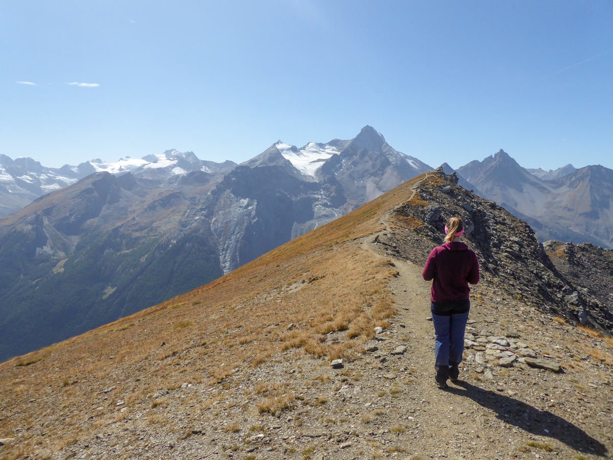 Hiker approaching the Col de Tza Seche peak in Cogne Valley Aosta Italy