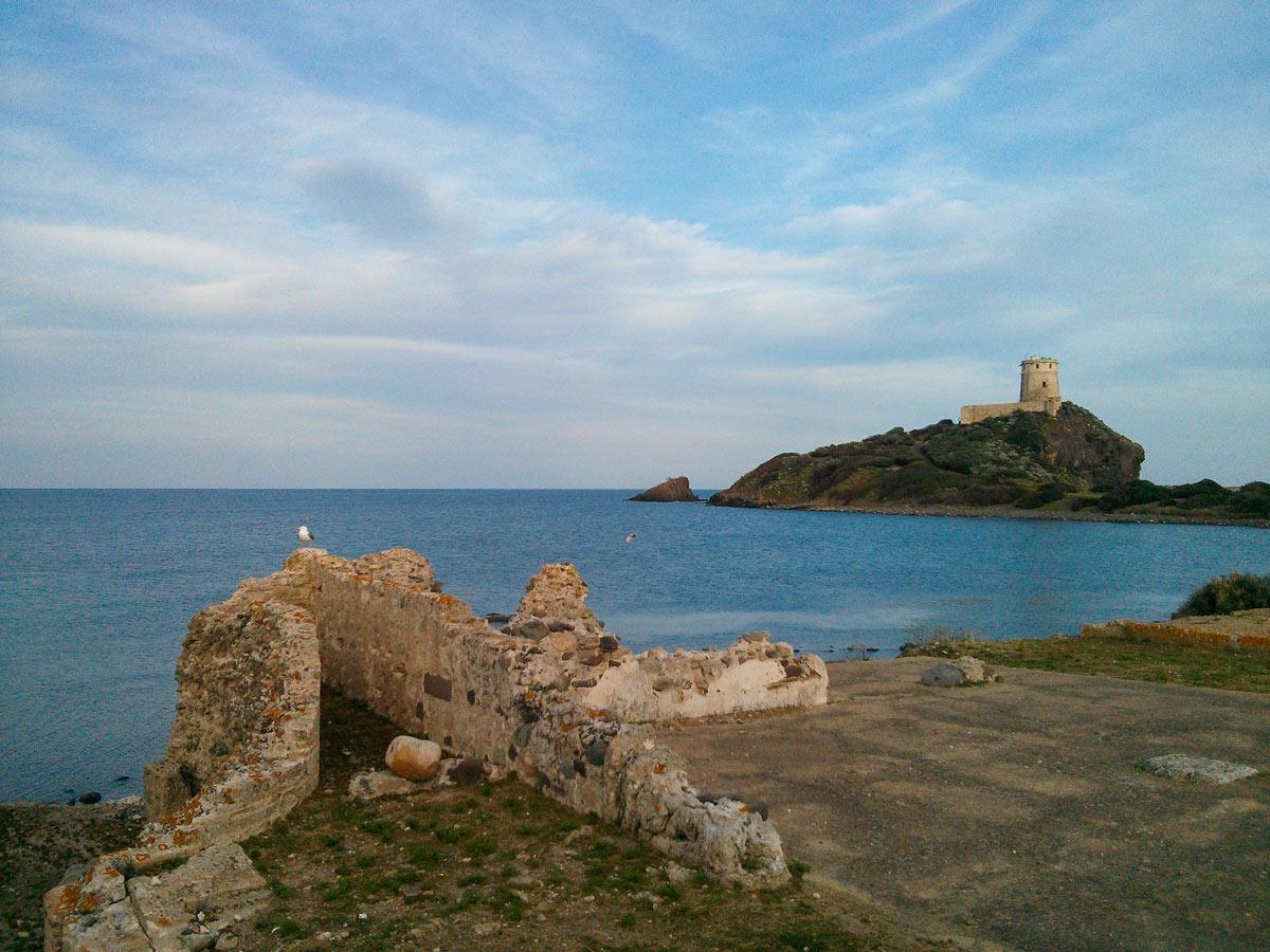Beautiful Mediterranean Sea and the lighthouse in Sardinia Island