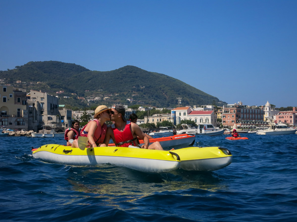 Two kayakers sea kayaking in Gulf of Naples in Italy