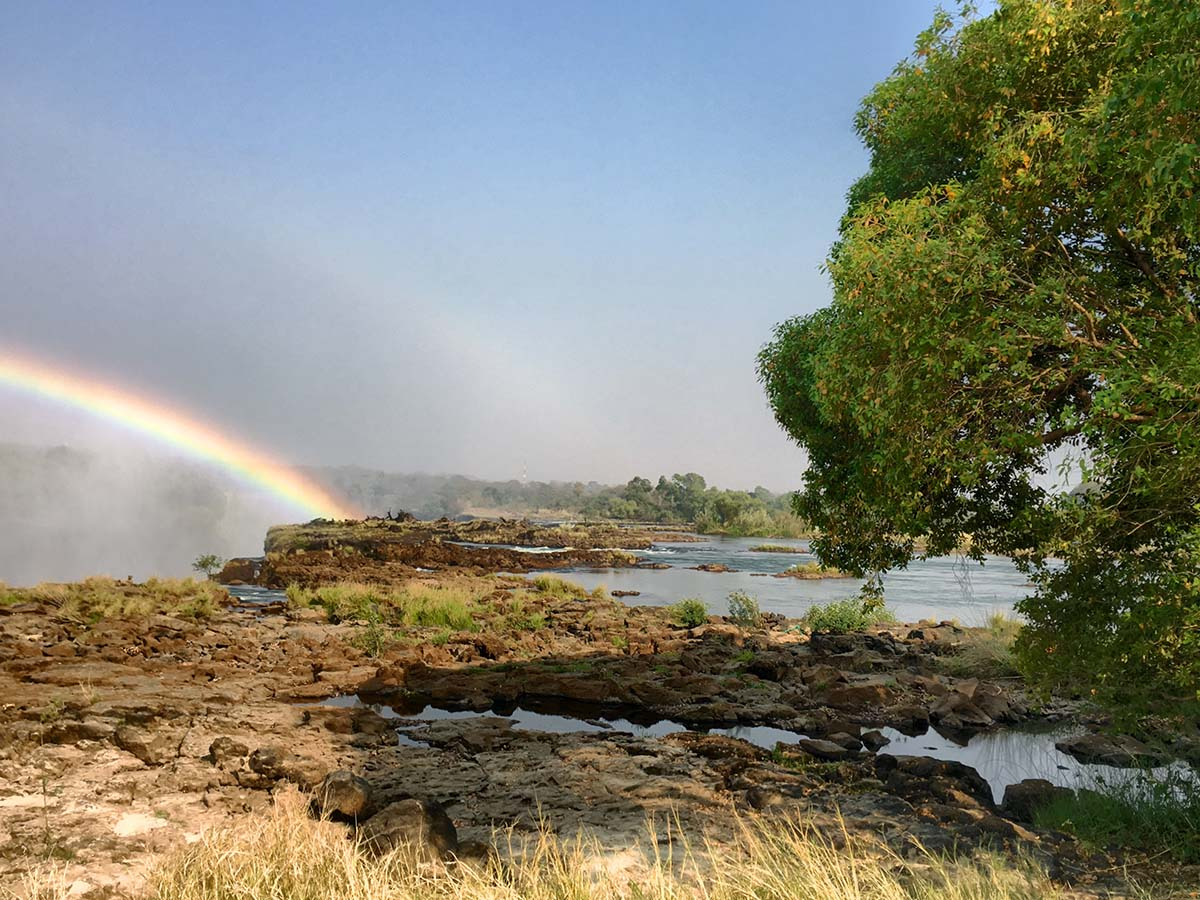 Rainbow over the Victoria Falls in Zimbabwe, seen on guided adventure tour