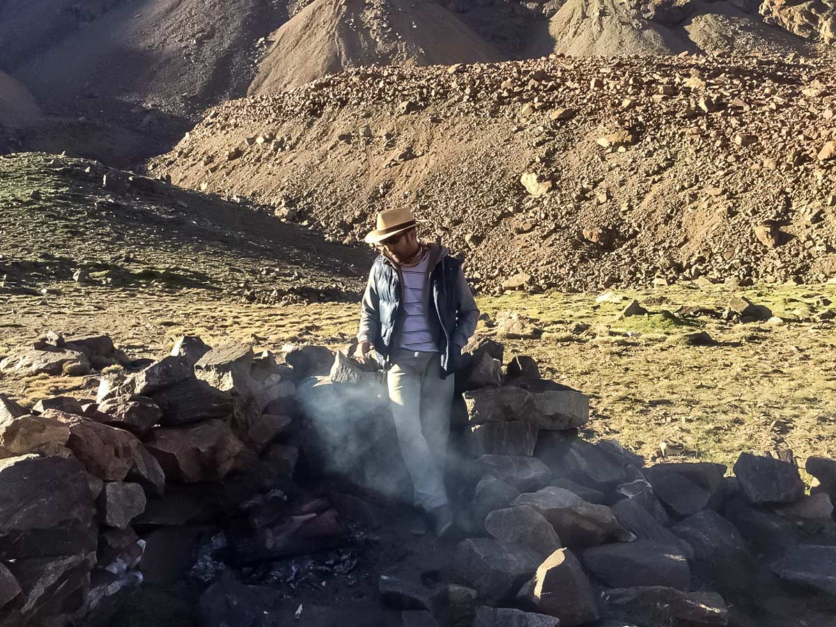 Camp cooking along Andes trekking tour in Argentina