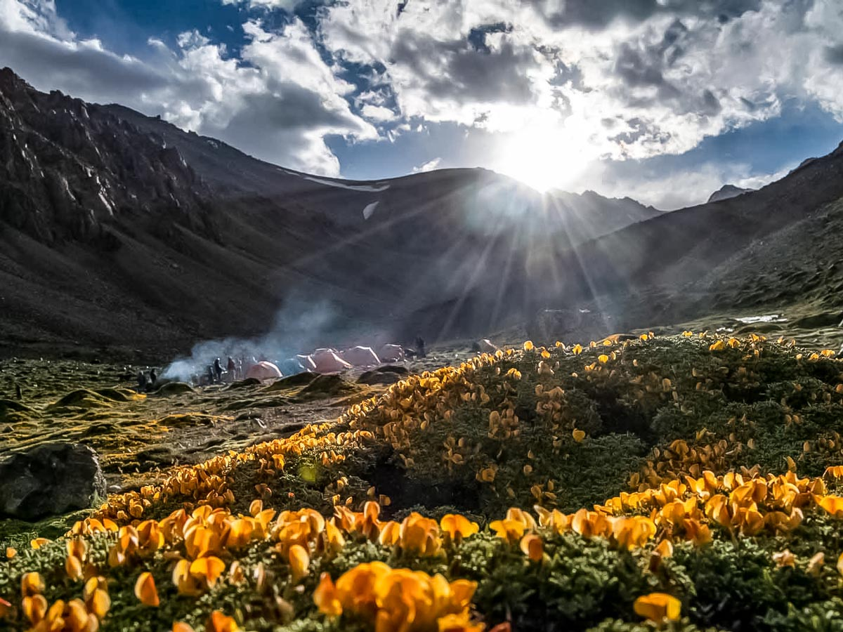 Sunrays over the campsite along Andes trekking tour in Argentina