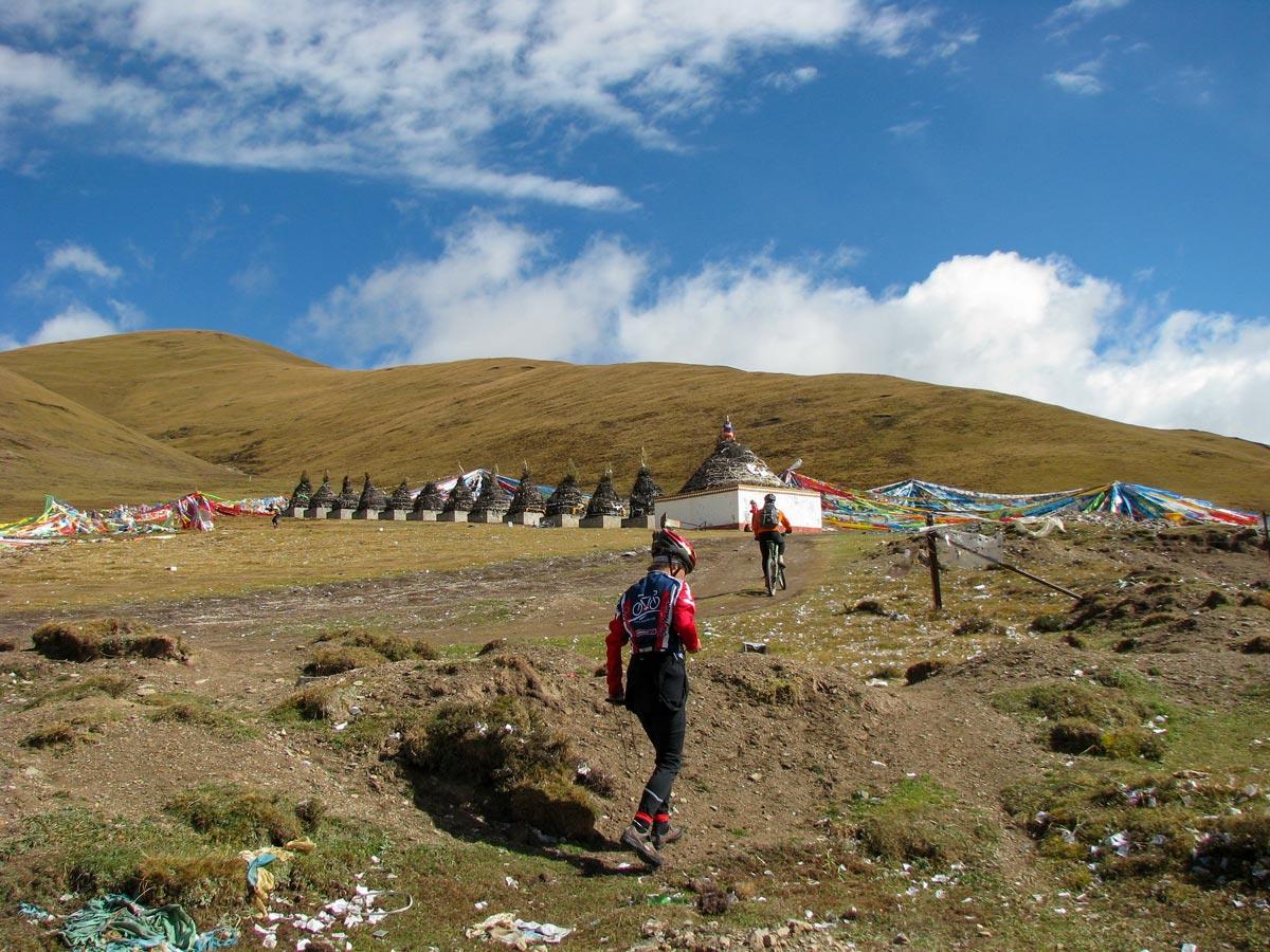 Bikers climb Holy Mountain of Amnye Machen in Tibet
