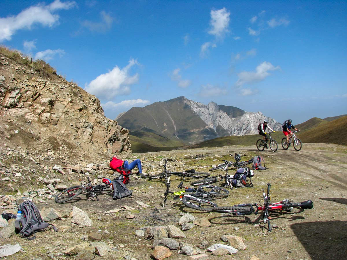Bikers rest along road up Amnye Machen in Tibet