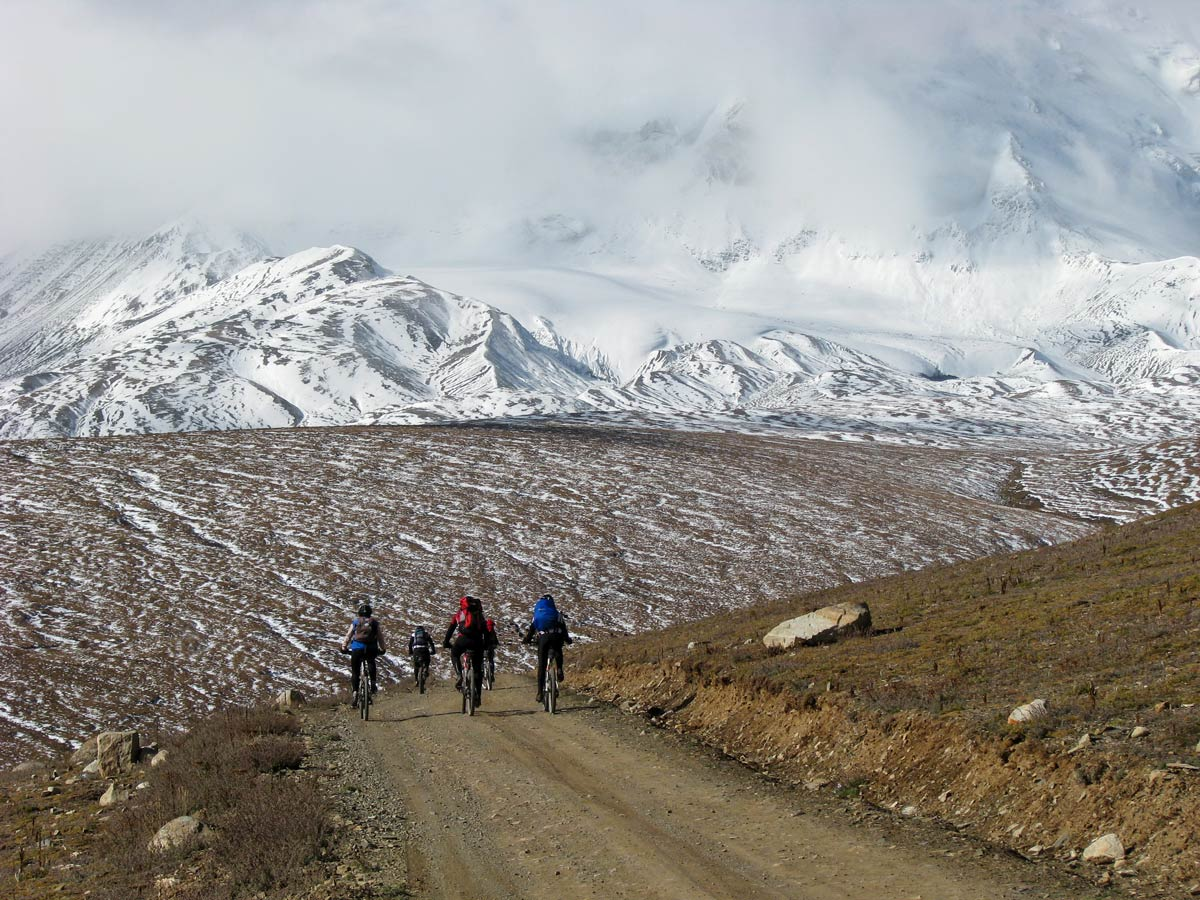 Biking along tohe road to Amnye Machen Base Camp in Tibet