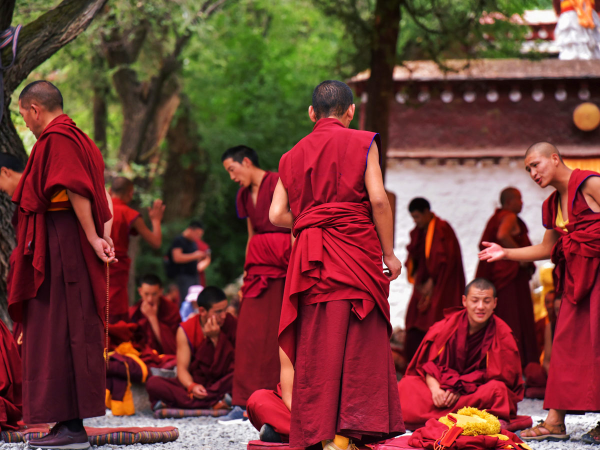 Debate between Monks in Sera along bike tour in Central Tibet