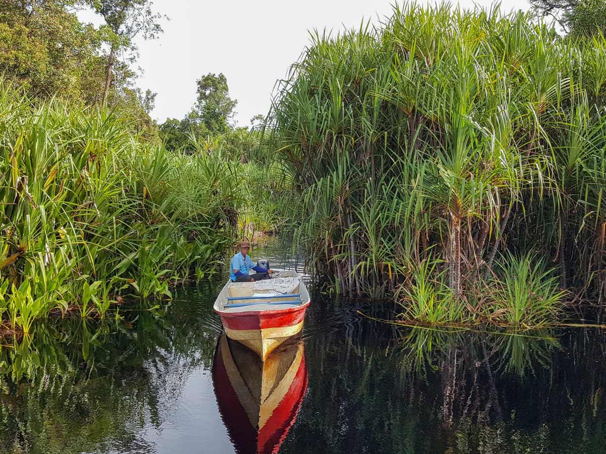 Boat on the river seen along Malasia Headhunters Heartland bike tour
