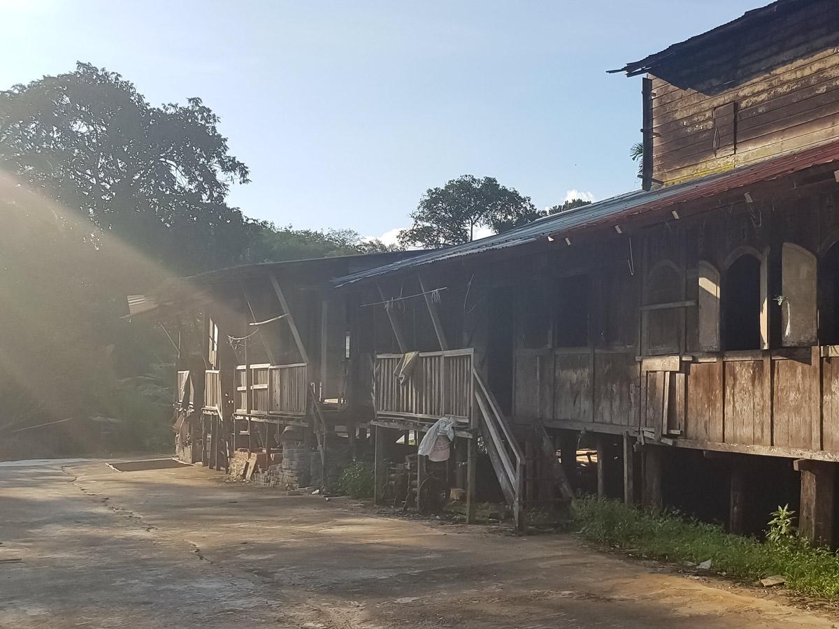 Sunrays on old house seen along Malasia Headhunters Heartland bike tour
