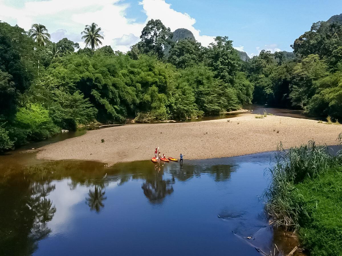 Kayak bike to remote beach Malaysia