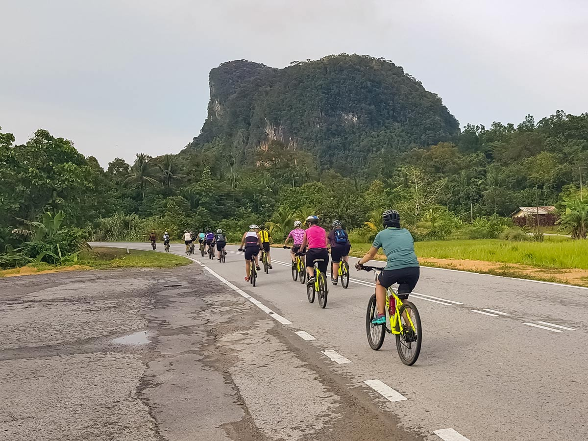 Bikers cycling to rainforest tour in Malaysia