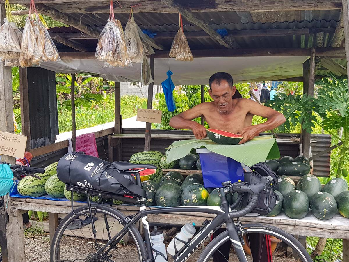 Fruit stand seen along Trans Borneo road bike tour Malaysia