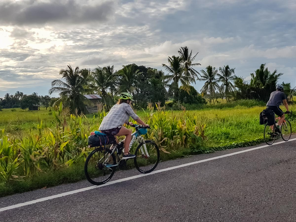 Cyclists road biking along Trans Borneo bike tour in Malaysia