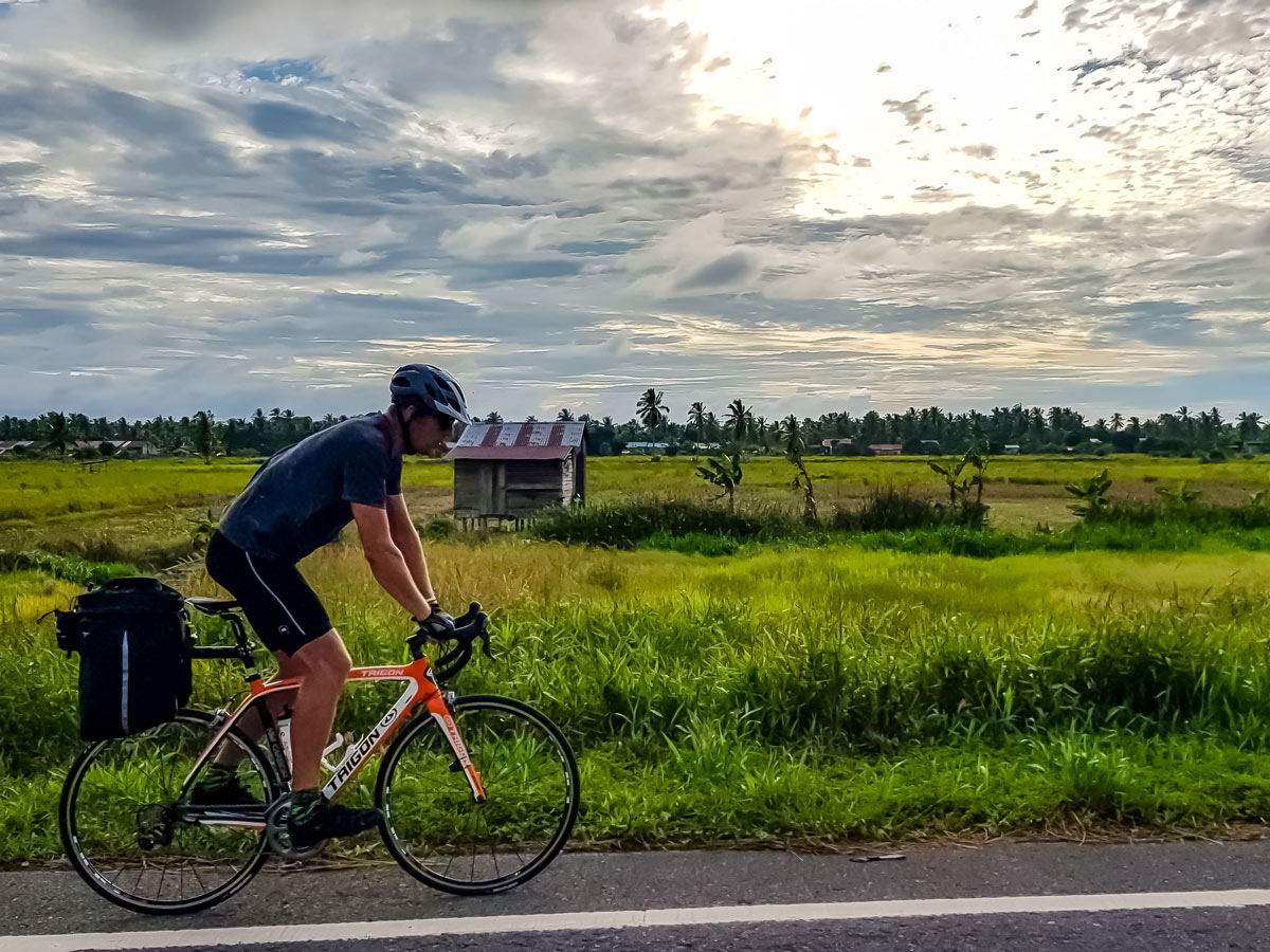 Road biking in Malaysia along Trans Borneo bike tour