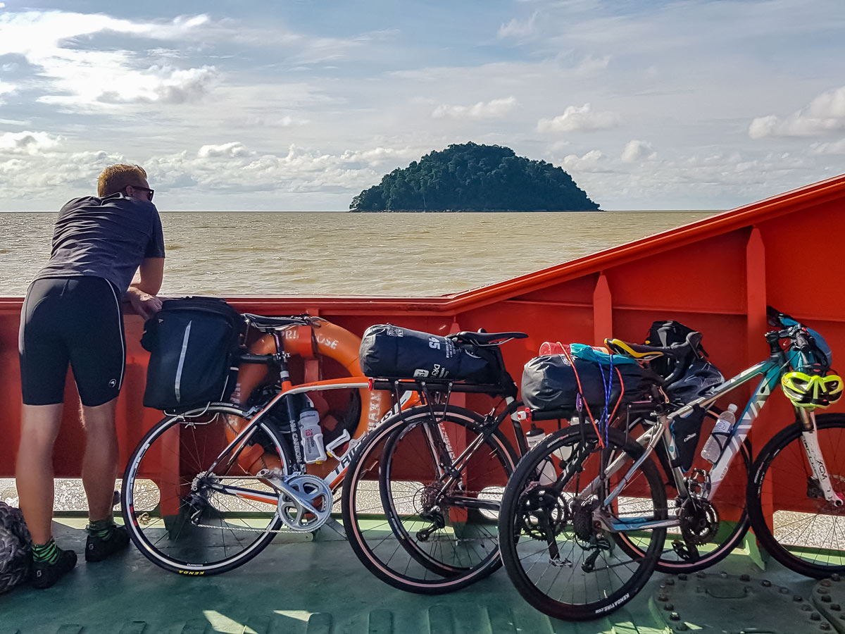 Ferry crossing along Trans Borneo road bike tour Malaysia