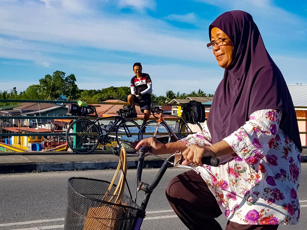Local woman seen biking along Trans Borneo bike tour Malaysia
