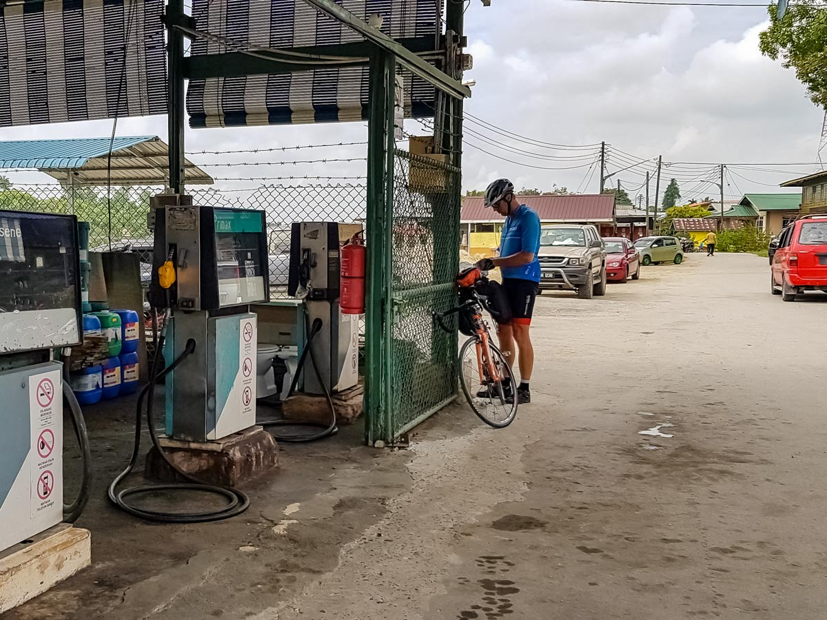 Rural gas station seen biking along Trans Borneo bike tour Malaysia