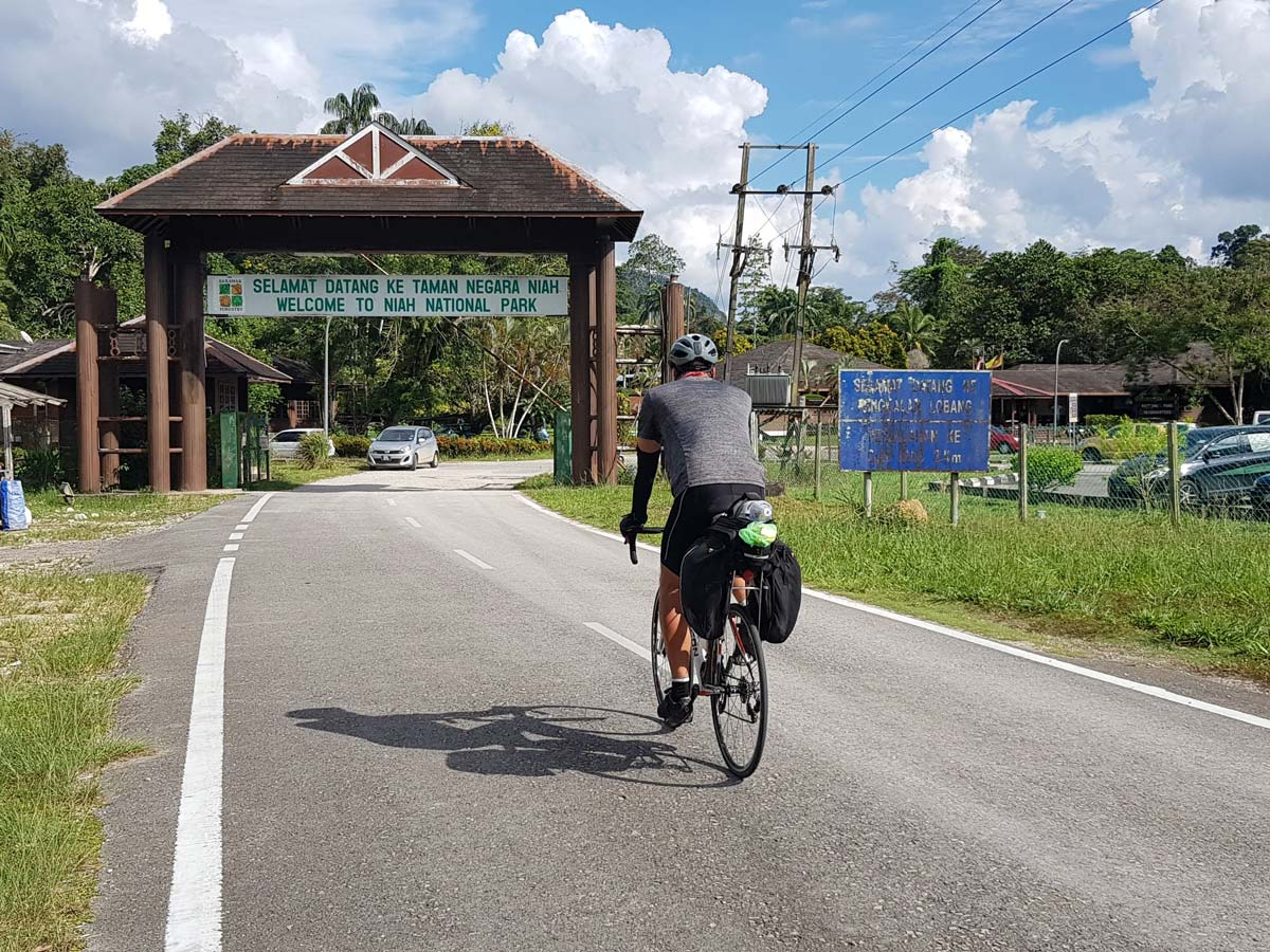 Biking through Niah National Park along Trans Borneo road bike tour Malaysia