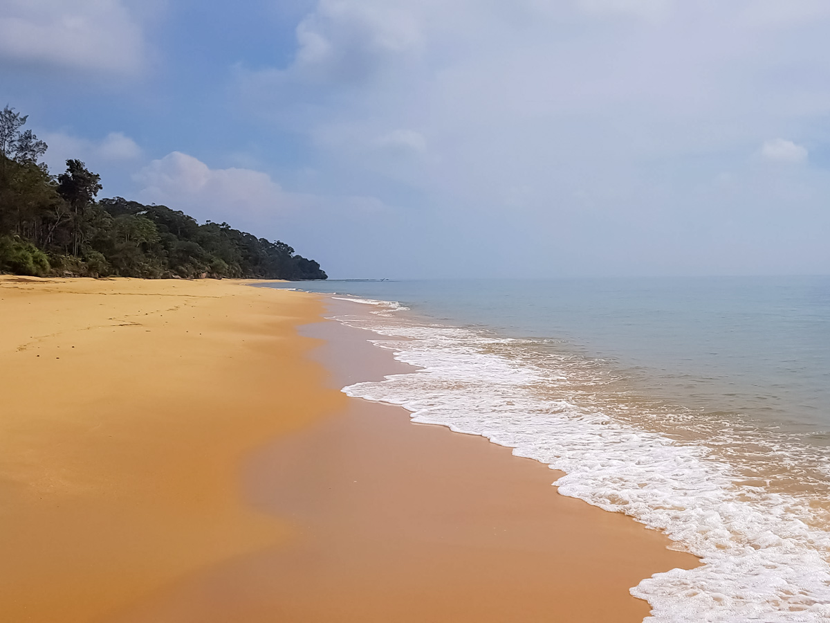 Beautiful beach along Trans Borneo road bike tour Malaysia