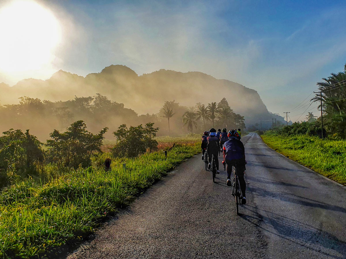 Beautiful road cycling in the sun along Trans Borneo road bike tour Malaysia