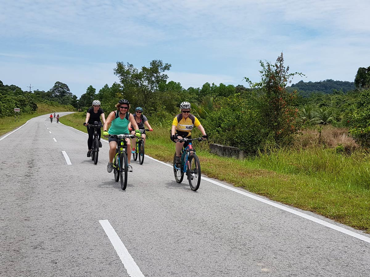 Biking along Sarawak Rainforest Adventure tour in Malaysia